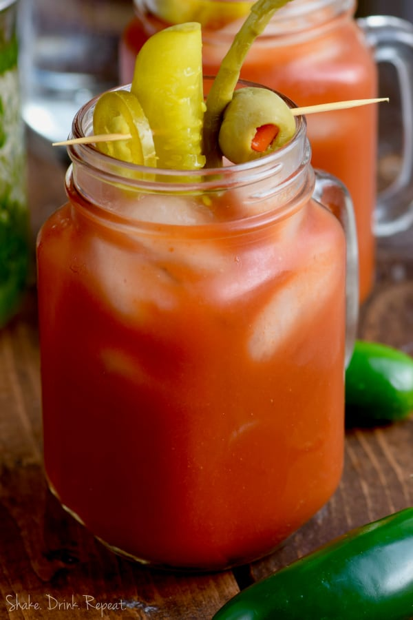 This Jalapeño Bloody Mary is the perfect spicy Bloody Mary recipe!  Made with my simple jalapeño infused vodka, it gives you the right kick you need for your Sunday brunch cocktail recipe!