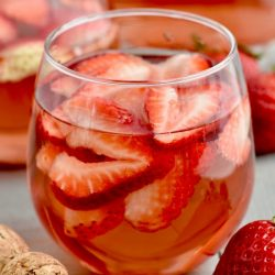 This Rose Sangria recipe with vodka is the perfect easy drink for a party or get together. This sparkling rose sangria is the perfect party drink!