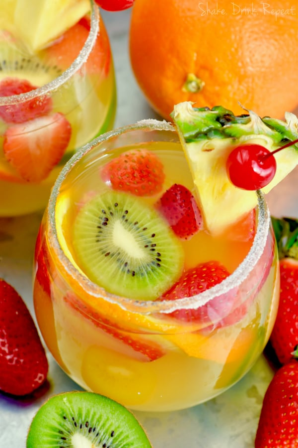 This Tropical Margarita Sangria is full of tequila, wine, and delicious fruit!