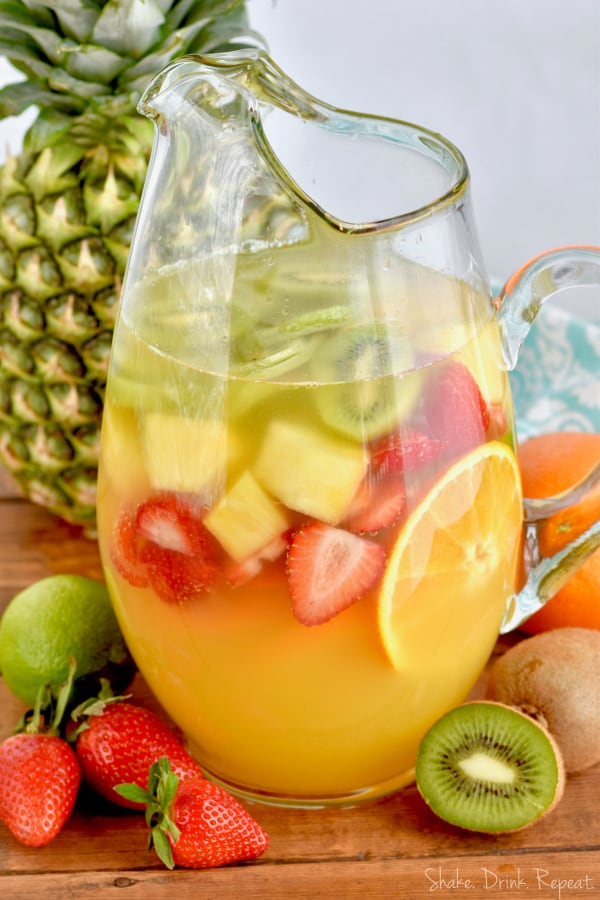 This Tropical Margarita Sangria recipe is easy and made with white wine and tequila!