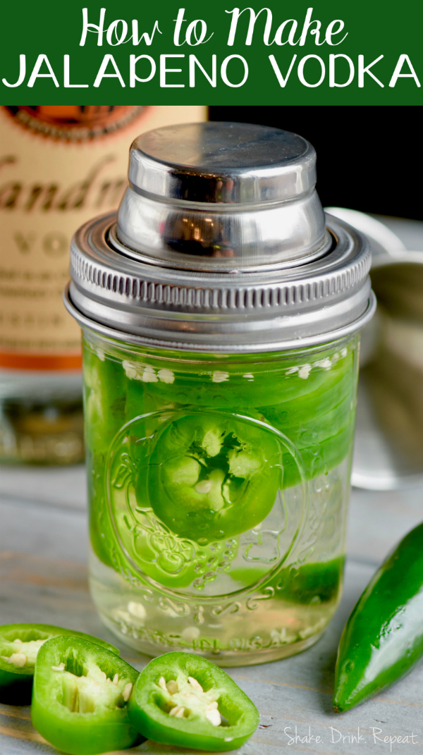 In a small mason jar, sliced jalapenos and vodka are combined. A reusable cap lid covers the top of the jar.