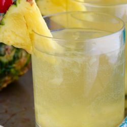 This easy Pina Colada Sangria Recipe comes together with only three ingredients! It is the perfect party drink! Make a double batch because it is that good!