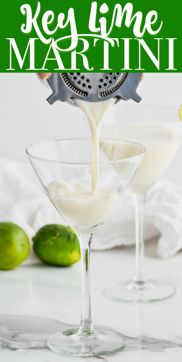 white key lime martini being strained into a martini glass