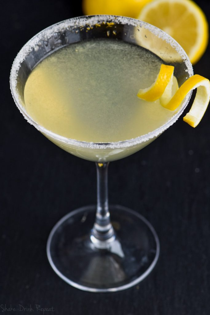 over head shot of lemon drop martini with sugar rim and lemon curl