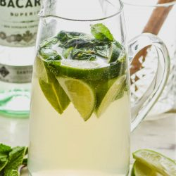 pitcher of mojito sangria recipe with limes and mint