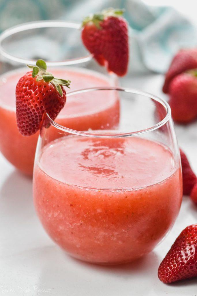 close up of wine glass with strawberry wine slushie