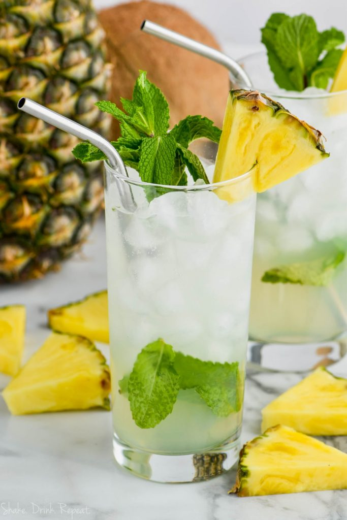pineapple mojito in a tall glass garnished with mint and fresh pineapple