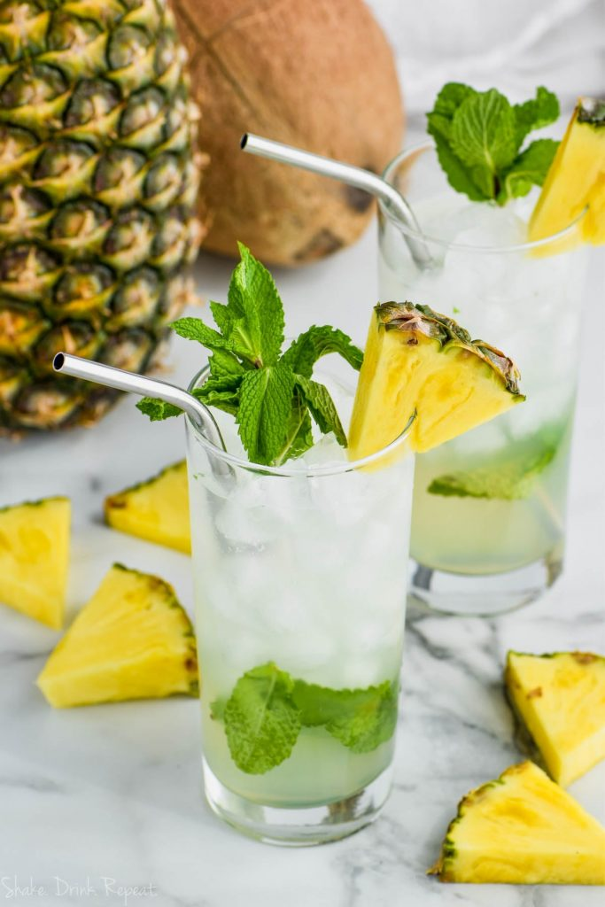 glass of pineapple mojito with pineapple and mint