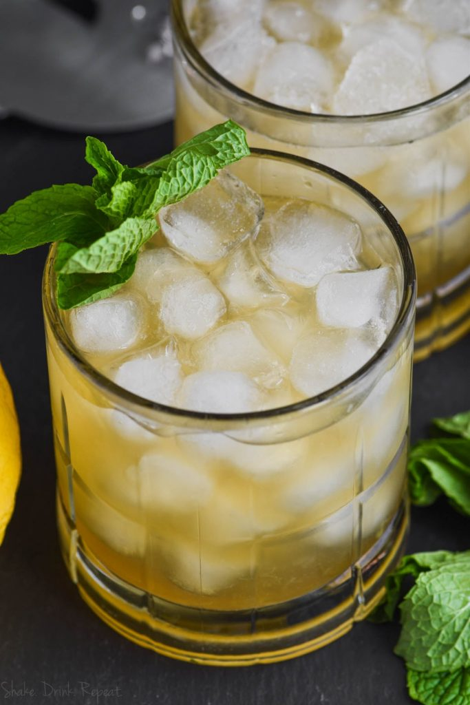 a whiskey smash cocktail recipe garnished with mint