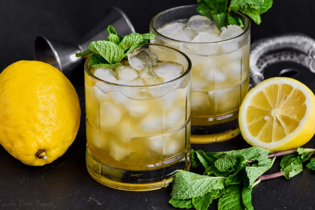 a whiskey smash recipe garnished with mint