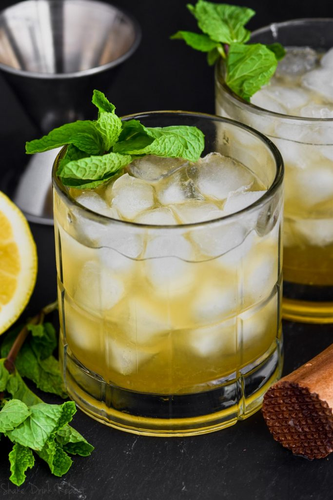 a whiskey smash cocktail garnished with mint