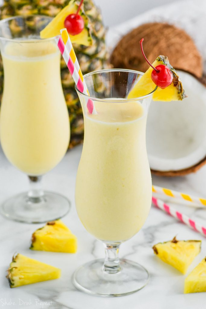 two hurricane glasses filled with easy pina colada recipe