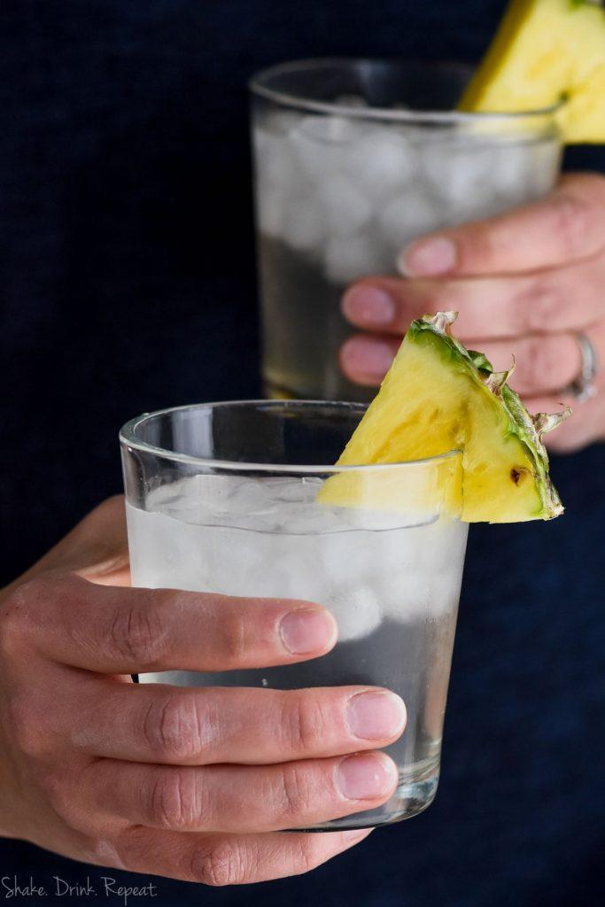 hand holding a pineapple vodka soda