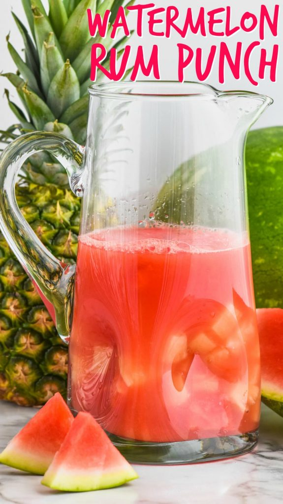 pitcher of watermelon rum punch cocktail with floating pineapple