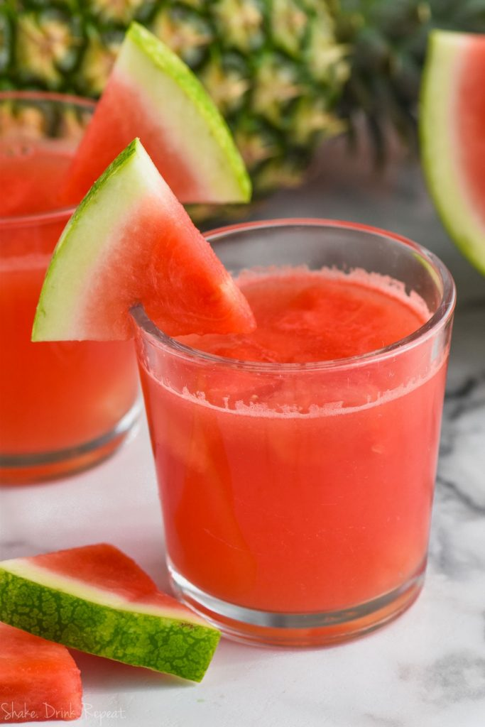 glass of watermelon rum punch with watermelon garnish