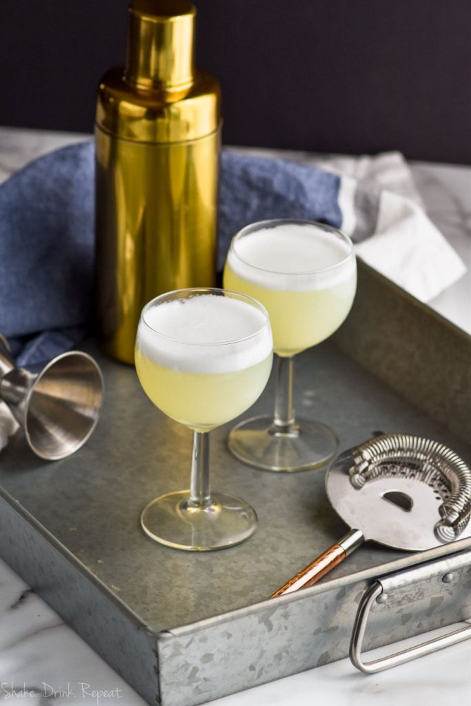 two gin fizz cocktails on a tray