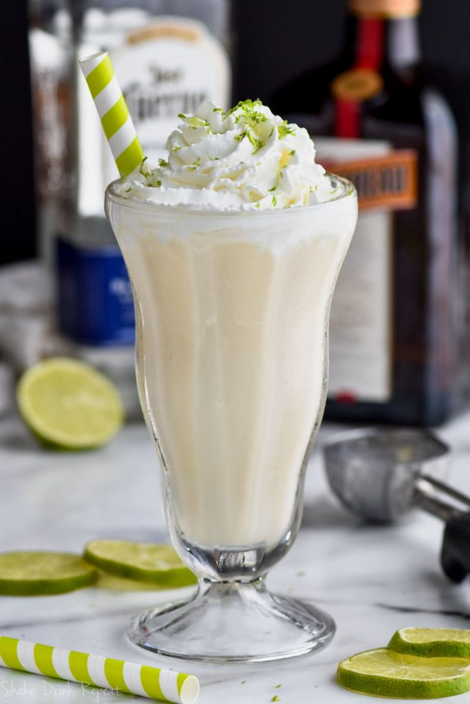 margarita milkshake recipe with alcohol bottles in the background