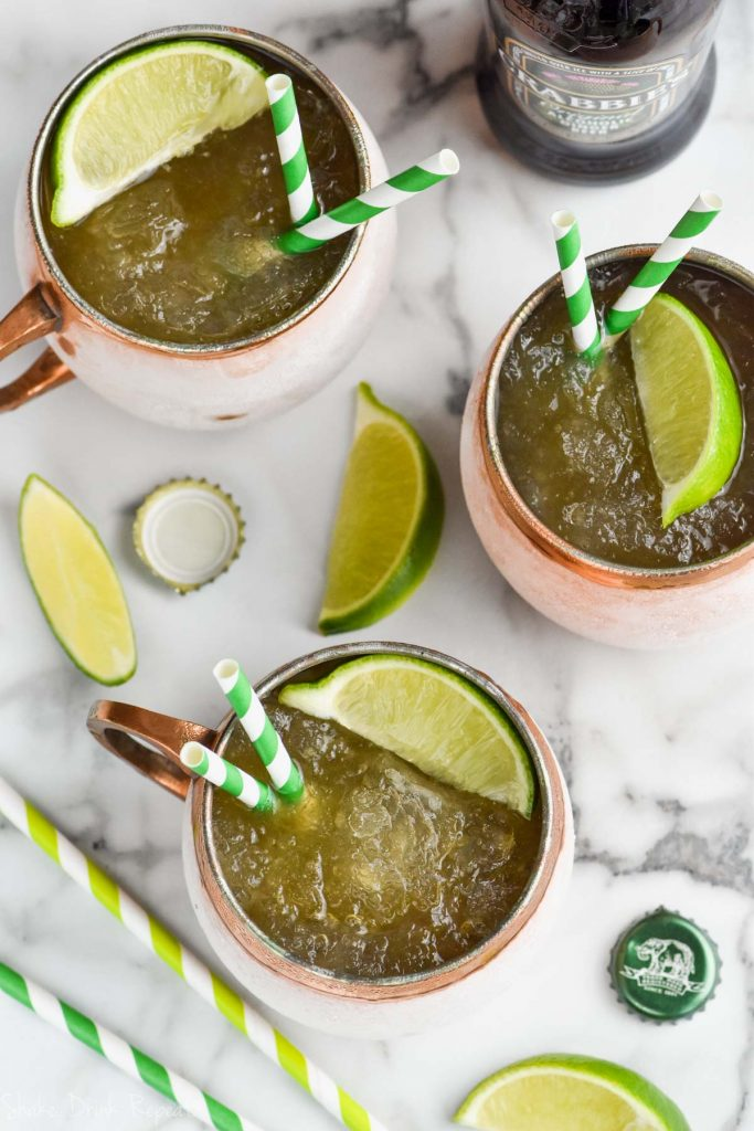 overhead view of three copper mugs with moscow mule slush