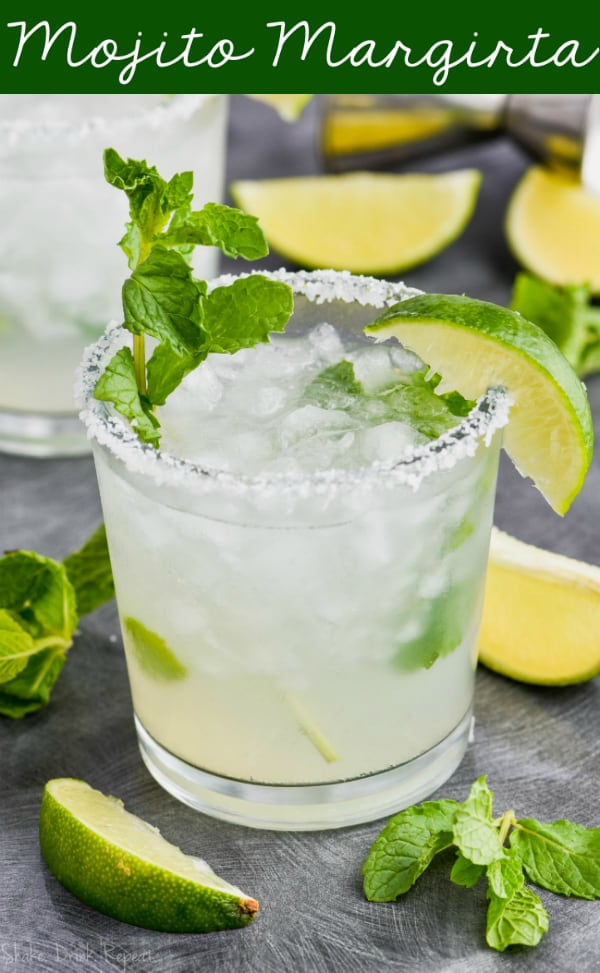 a mojito margarita in a salt rimmed glass with fresh mint and a lime wedge