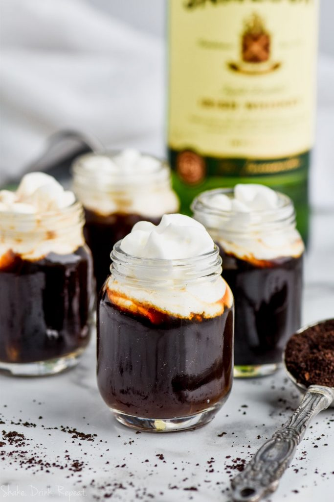irish coffee shots topped with whipped cream