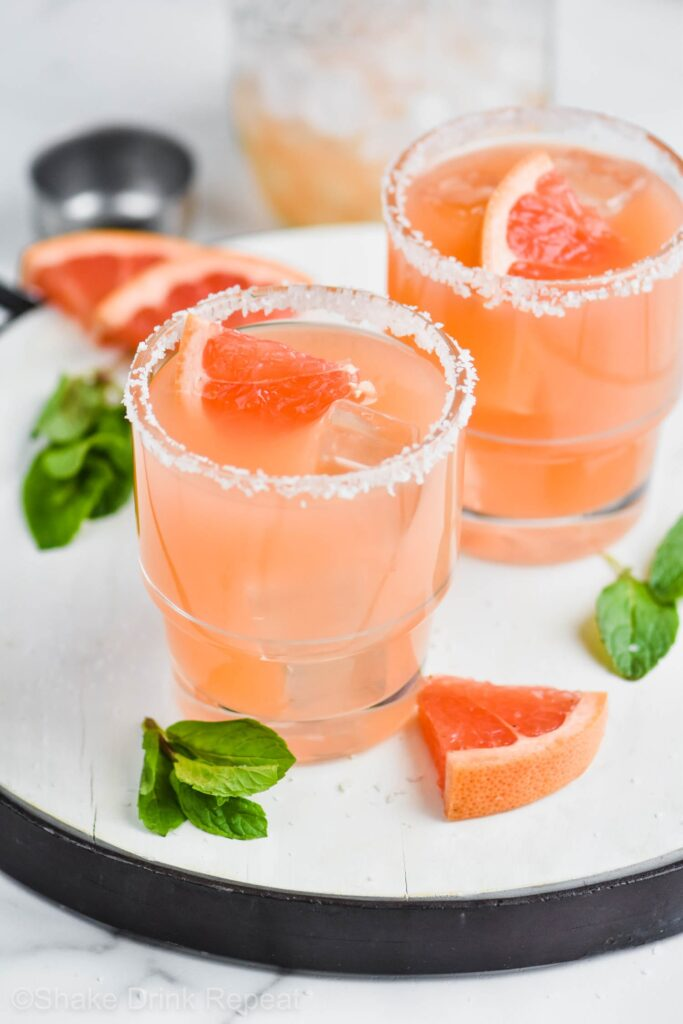 Salty Dog is glass with mint and grapefruit garnish