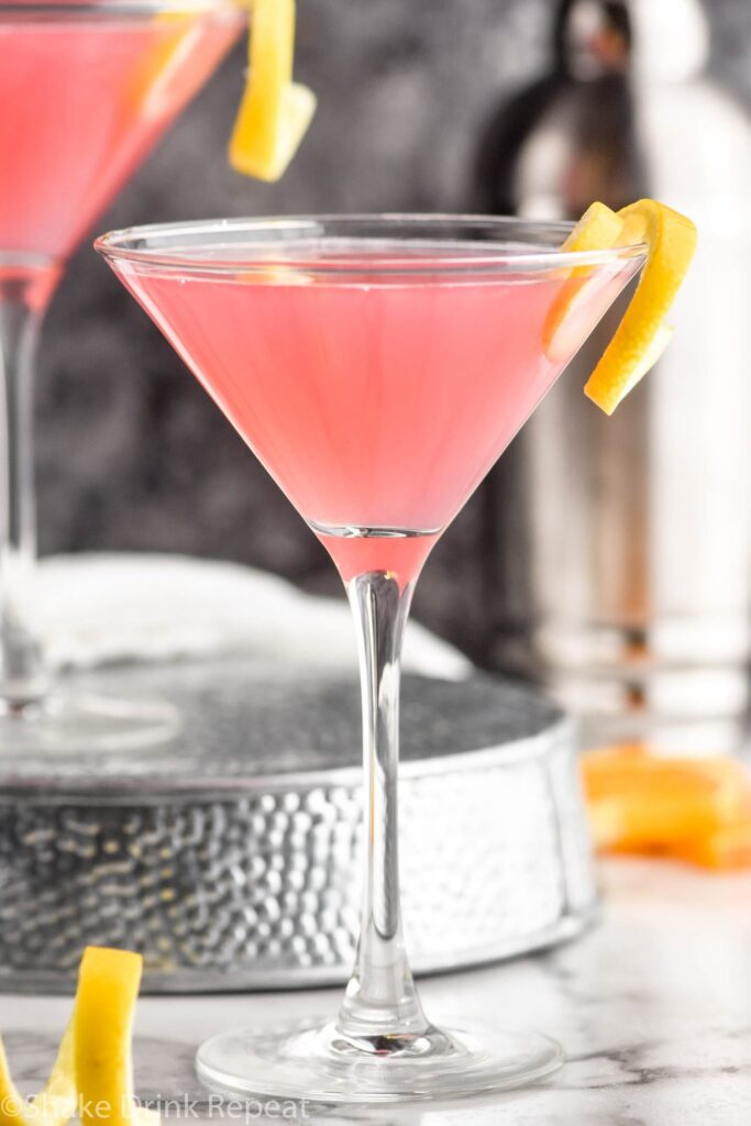 Cosmopolitan Cocktail in a glass garnished with a lemon twist