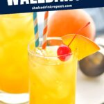 glass of Harvey Wallbanger drink with orange wedge and cherry garnish and straws