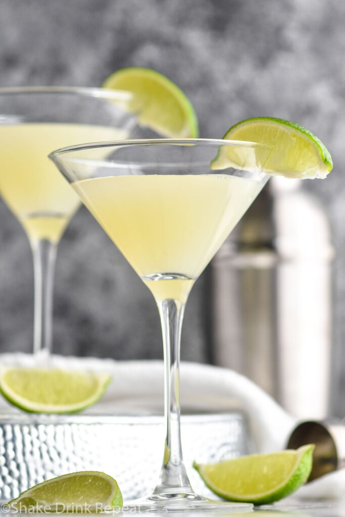 two martini glasses Kamikaze Drink with lime wedge garnish