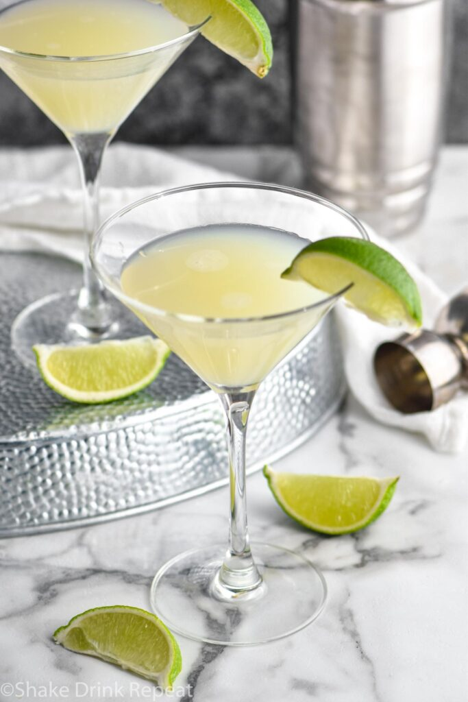 two martini glasses of Kamikaze Drink with lime wedge garnish