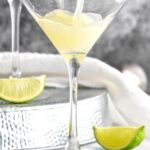 Kamikaze Drink poured into martini glass with lime wedge garnish