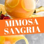 pitcher of mimosa sangria recipe with orange slices and strawberry