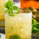 glass of mint julep recipe with shaved ice and fresh mint leaves garnish