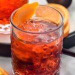 glass of Negroni with ice and orange twist