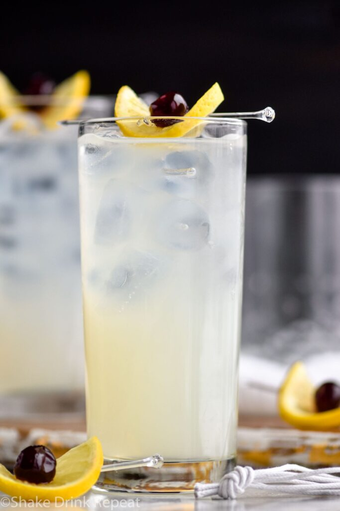 two glasses tom collins with ice, lemon, cherry