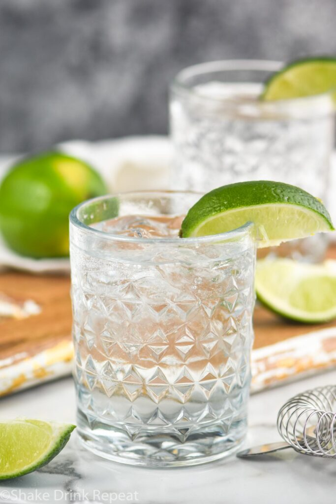 two glasses vodka tonic with lime wedge