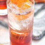 glass of Americano cocktail with ice and orange slice garnish