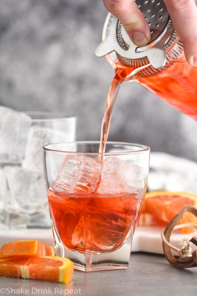 boulevardier recipe ingredients in glass with ice and orange garnish