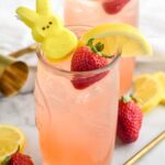 Drunk Bunny Cocktail in glass with ice, peep, lemon wedge and strawberry.