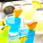 glasses of kamikaze shots with orange and lime wedges