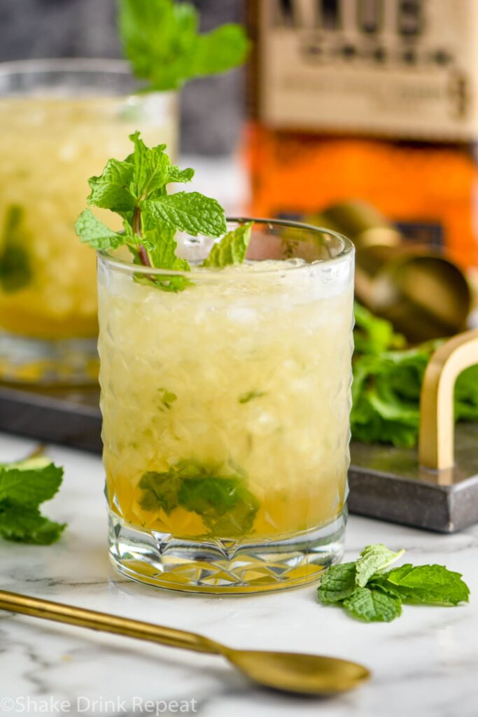 glass of mint julep cocktail with ice and bourbon
