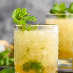 two glasses of mint julep cocktail with mint garnish