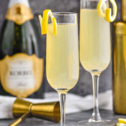 two glasses of french 75 with lemon twist and champagne
