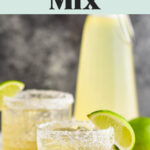 two glasses with salted rims of margaritas made with homemade margarita mix, lemons and limes