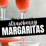 glasses of frozen margaritas with sugared rim and fresh strawberries