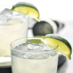 two glasses of vodka gimlet with ice and limes
