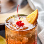 glass of wisconsin brandy old fashioned with ice, cherry, and orange