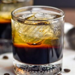glass of mind eraser cocktail with ice and coffee beans