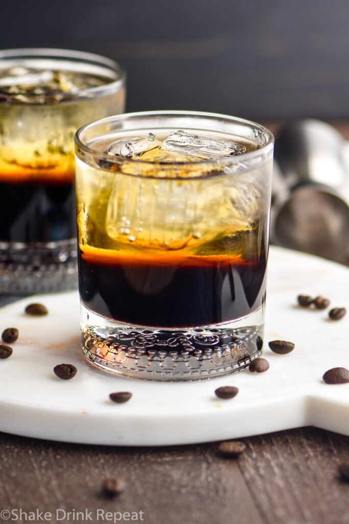 two glasses of mind eraser cocktails with ice and coffee beans