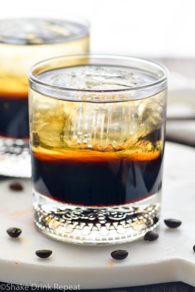 two glasses of mind eraser cocktail with ice and coffee beans