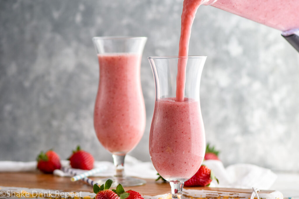 two glasses of blended strawberry colada recipe